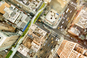 Aerial shot of New York City NYC with yellow taxis dotted around the scene